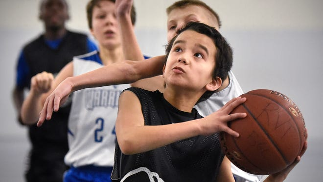 Kaiden Moua puts up a shot during a tournament game Saturday, Jan. 9, in the Halenbeck Hall field house at St. Cloud State University.