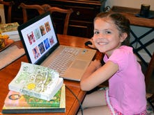 Emmie Enchanted: Greenwood girl creates book review website