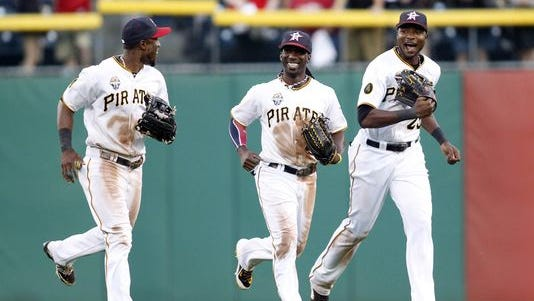 """""""There's nothing they don't think they can do,"""" manager Clint Hurdle says of, from left, Starling Marte, Andrew McCutchen and Gregory Polanco."""