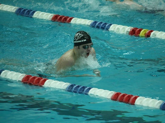 Swimming to a first-place finish in the 200 IM Thursday