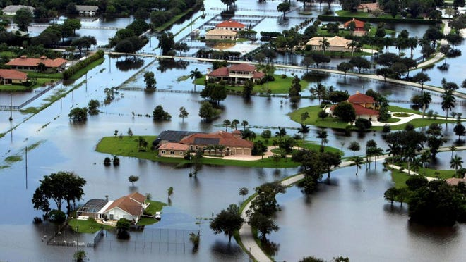 Aerial photo of flooding caused by Tropical Storm Isaac near Lake Worth Road and South Shore Boulevard in Wellington on Aug. 28, 2012.