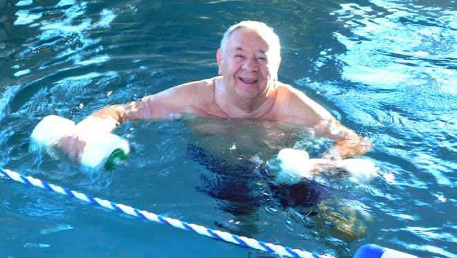 Tony Mulert does his usual pool workout at the Shorehaven Strength and Fitness Center.