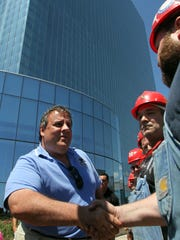ATLANTIC CITY - 8/12/11 - Governor Chris Christie greets workers at the Revel Resort site in Atlantic City Friday afternoon. ASBURY PARK PRESS PHOTO BY THOMAS P. COSTELLO   CHRISTIE0812A
