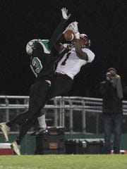 Clear Fork's Jake Lowe breaks up a pass in last week's win over Marion Harding.