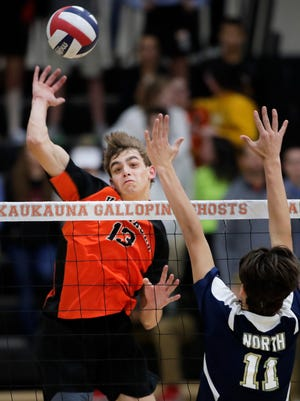 Kaukauna High School's Austyn Bella looks to get the ball past Appleton North High School's blocker Cade Coenen Thursday, Nov. 2, 2017, in Kaukauna, Wis. Danny Damiani/USA TODAY NETWORK-Wisconsin