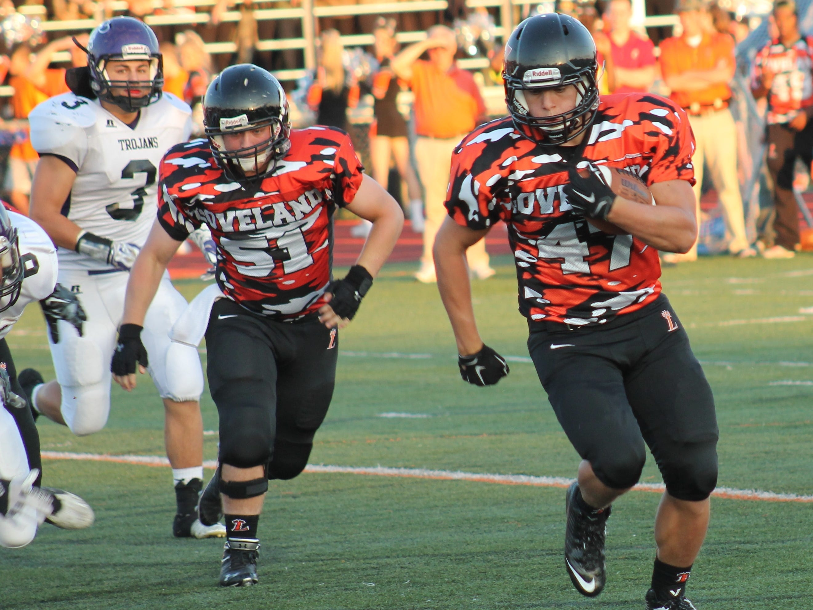 Loveland senior Nate Slagel rolls for a touchdown Sept. 18 against Glen Este in his final prep football game.