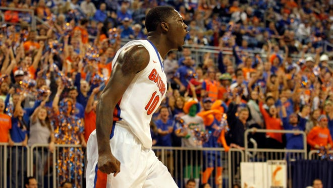 Florida Gators forward Dorian Finney-Smith (10) reacts after he dunked against the William & Mary Tribe during the first half at Stephen C. O'Connell Center.