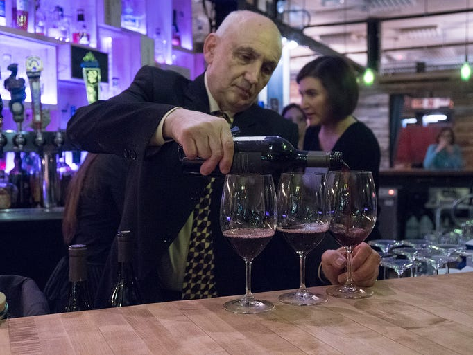 John Jonna, the dean of local wine experts, pours two