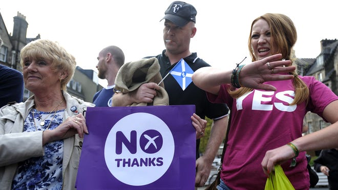 Supporters for and against Scottish independence attend a pro-union rally in Edinburgh on Sept. 8.