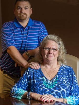 Matthew Hoagland and his mother, Linda Iseler, posed for a portrait in Fort Wayne on Thursday, July 28, 2016. Iseler's ex-husband, Richard Hoagland, left her and their family unexpectedly in 1993 and was recently found to be living in Florida under the stolen identity of a dead man. Iseler said Matthew has been her rock throughout the experience.