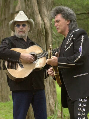 """Country music singers Merle Haggard, left, and Marty Stuart perform during a news conference in 2003 in Oxford. Stuart called Haggard, who died Wednesday, the last of """"the old group of kings."""""""