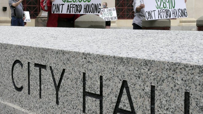 Advocates for low-wage workers demonstrated at City Hall in downtown Columbus on Thursday, May 28, 2020, calling for more affordable housing and assistance for those facing eviction due to the coronavirus pandemic.
