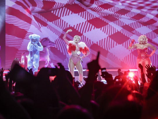 Miley Cyrus performs at the Palace of Auburn Hills in 2014.