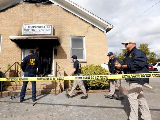 ATF agents gather outside the fire damaged Hopewell