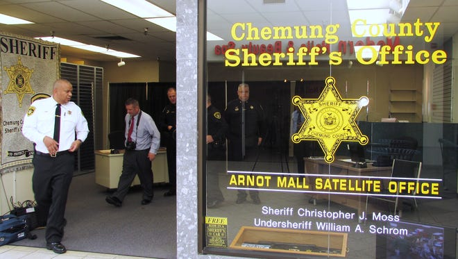 Chemung County Sheriff Christopher Moss, left, shows off the new sheriff's satellite office at Arnot Mall.