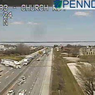 A disabled vehicle is slowing traffic on I-83 southbound