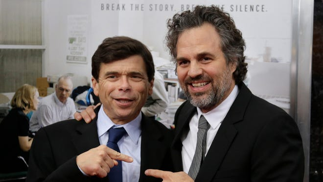 "In this Oct. 28, 2015 file photo, Pulitzer Prize-winning investigative reporter Michael Rezendes, left, stands for a photograph with actor Mark Ruffalo, who plays Rezendes in the film ""Spotlight,"" as they attend the Boston area premiere of the film at the Coolidge Corner Theatre, in Brookline, Mass. The film tells the story of how The Boston Globe reported on the clergy sex abuse scandal."