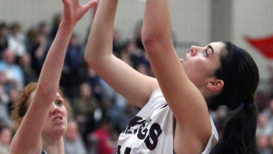 Valhalla's Kaitlyn Doherty shoots over Putnam Valley's