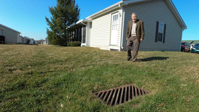 Fred Neil, a resident of Wild Meadows in Dover, shows a sinkhole behind his home on April 1. Wild Meadows residents challenged proposed lot-rent hikes in their community.
