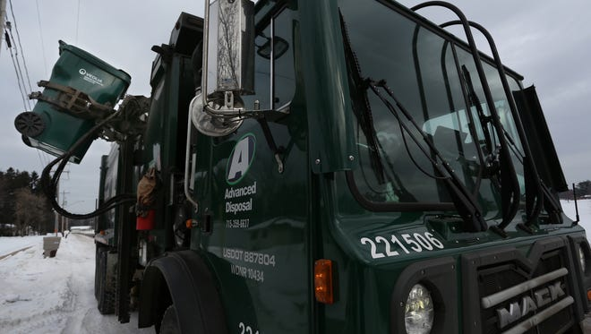 In this 2015 file photo, a truck from Advanced Disposal picks up a garbage container in Weston. Wisconsin Rapids is considering buying a similar truck.