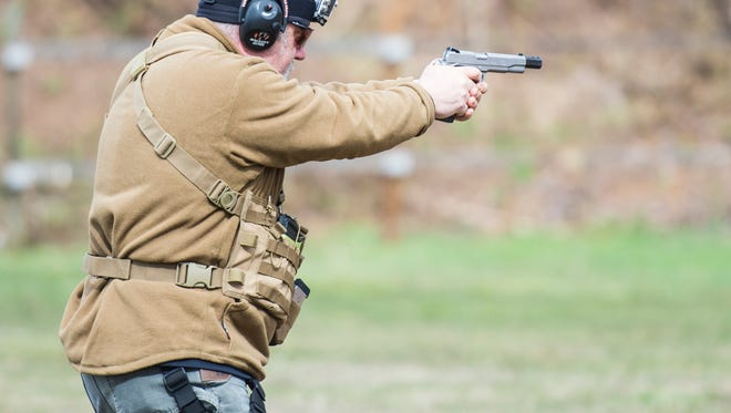 Joe Murray competes in the pistol portion during the 3-gun competition at the Lebanon County Police Combat Pistol Club on Saturday, April 1, 2017.