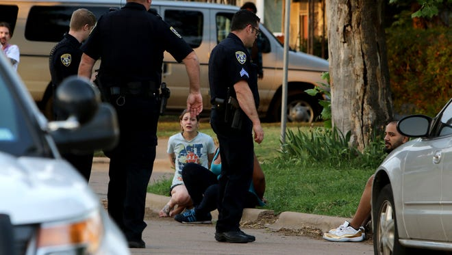 Police interview witnesses about an assault that left a Wichita Falls man hospitalized Sunday with life-threatening injuries  Sunday.