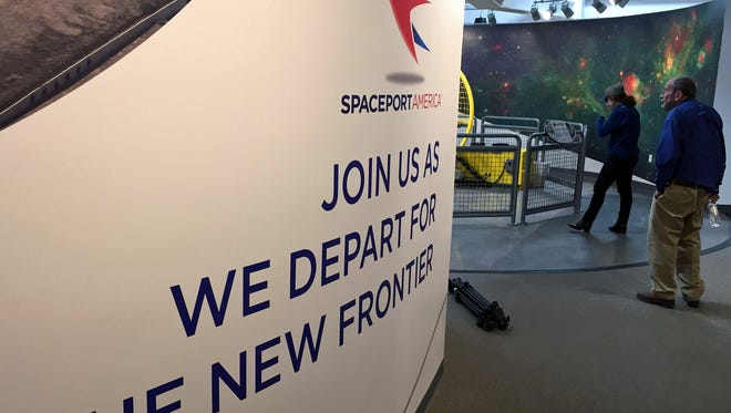 Economic analyst Erin Ward and New Mexico State University economist Jim Peach check out the visitor's center at Spaceport America during a tour of the facility in April 2017.