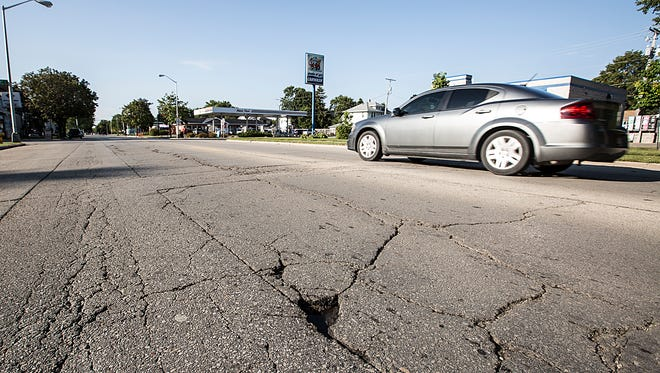 Cracks in the roadway show up along Main Street in Fond du Lac. Repairs are scheduled for next year. Friday September 8, 2017. Doug Raflik/USA TODAY NETWORK-Wisconsin