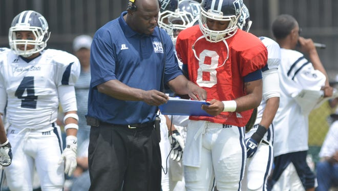 Jackson State running backs coach Destry Wright works with quarterback Brendon Zachary during the 2014 spring game.