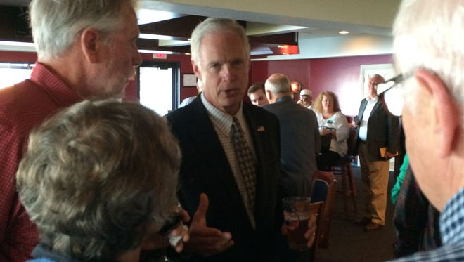 Sen. Ron Johnson talks to people attending a Republican Party of Door County reception Saturday.