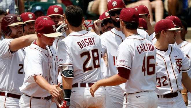 Dylan Busby is congratulated after Saturday's home run against Duke during the ACC Tournament.