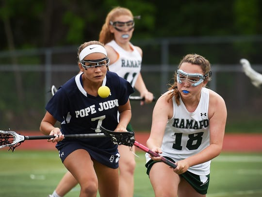 Caitlin Wolfe (no. 18) of Ramapo tries to reach a loose