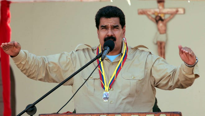 Venezuela's Nicolas Maduro speaks to soldiers inside a military base in Coro on Monday. Maduro expelled the top U.S. diplomat and two other embassy employees for allegedly conspiring with the political opposition.