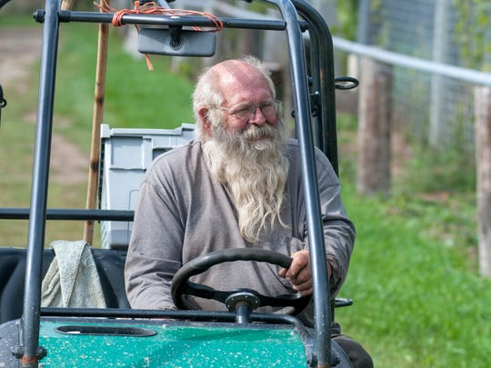 Chuck Vanneste, chief executive officer, rides around in his utility vehicle at the Summer Wind Farm Sanctuary in Brown City.