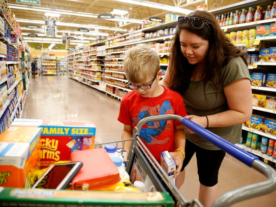 Annie Varland of Fort Thomas, shops for Kroger Brand