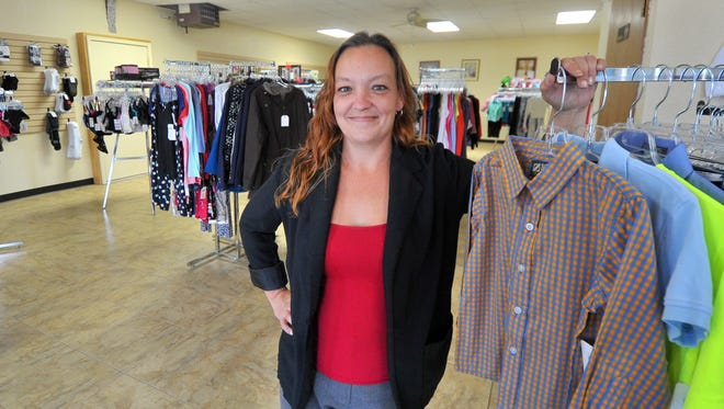 Owner Tricia Wallstrom stands in Mystic's, a new resale shop in Weston.