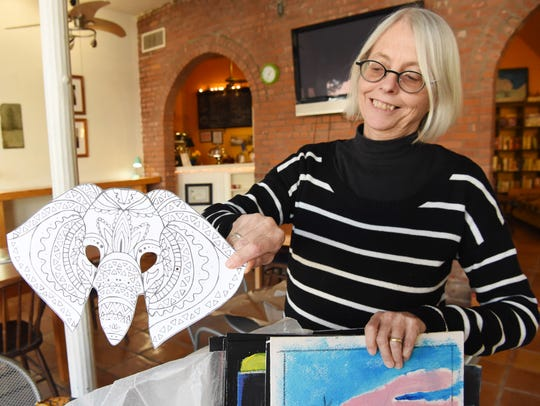 Nancy Donskoj, co-chair of the Kingston Sinterklaas Committee, shifts through some artwork to be used during last year's Sinterklaas Festival.