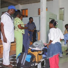 Patients arrive on September 21, 2014, at a new Ebola treatment center that opened in Monrovia, Liberia.
