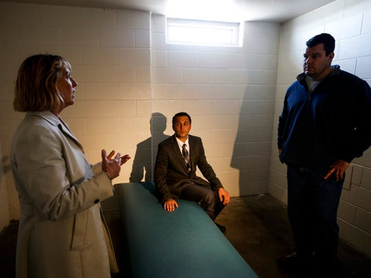 Patti Wachtendorf, warden of the Iowa Correctional Institution for Women  shows Rep. Bobby Kaufmann, R-Wilton, and Sen. Chaz Allen, D-Newton  a solitary confinement cell at the Iowa Correctional Institution for Women Friday, April 10, 2015.