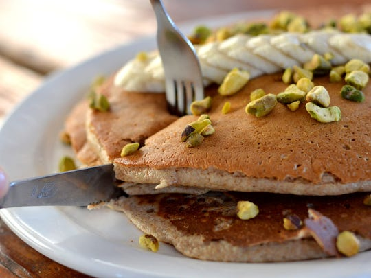 The whole-wheat Pancakes from Queen Creek Olive Mill are made from scratch using Hayden Flour Mill's whole-wheat flour, vanilla bean olive oil, fresh banana, local pistachios and served with pure maple syrup.