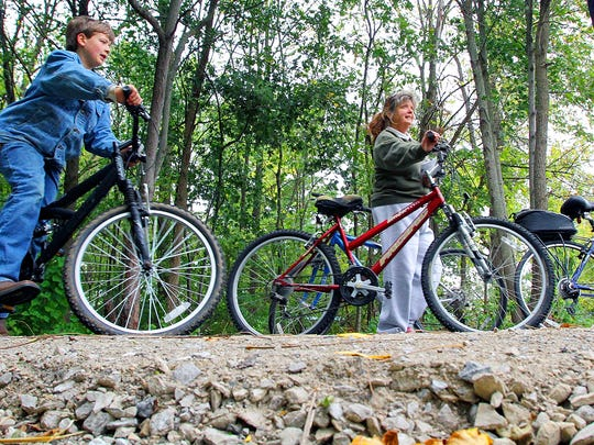 Bicyclists use Tallgrass Trail.