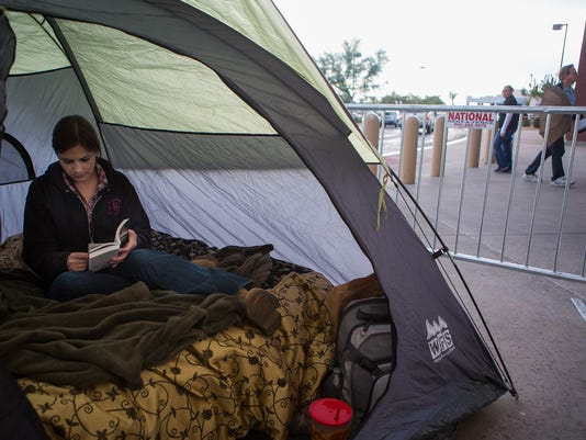 Woman Camps in front of Best Buy for Black Friday Deals