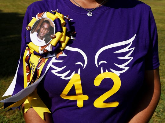 Janetta Brakefield wears a T-shirt with her son's number on it. Javier Simpson, a Logansport defensive back, drowned June 4 in the Sabine River.