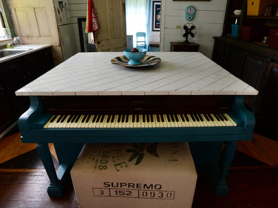 A piano that has been turned into a kitchen island during renovations that Chris Parker and Jackie Lewis are making to the 1888 two-story dogtrot home in rural Bienville Parish.