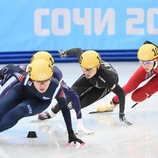 Feb 21, 2014; Sochi, RUSSIA; Jessica Smith of the USA, center, during short track speed skating ladies' 1000m Final at the Sochi 2014 Olympic Winter Games at Iceberg Skating Palace. Mandatory Credit: Robert Deutsch-USA TODAY Sports