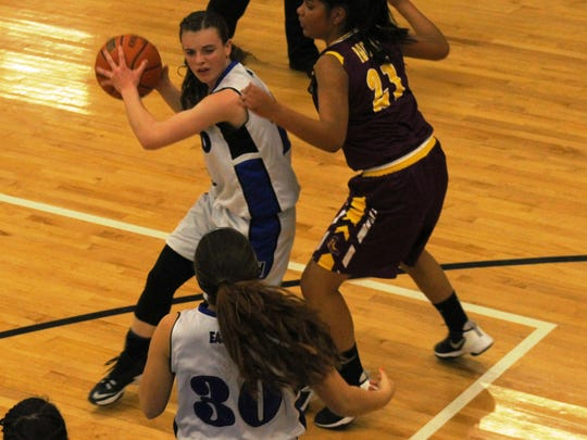 Hondo's Joyce Ann Cooper maintains possession of the ball during their Valentine's Day game with Vaughn.