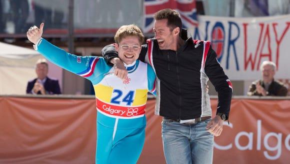 Eddie (Taron Egerton) and his coach Bronson Peary (Hugh