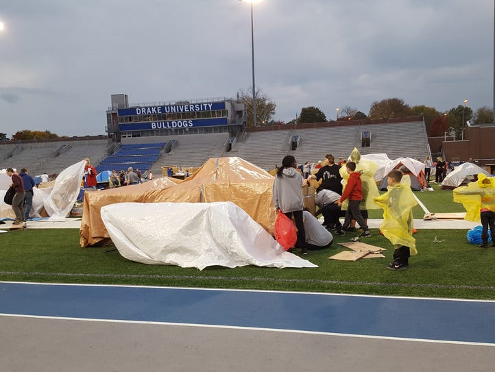 Teams prepare for the rain at Reggie's Sleepout on