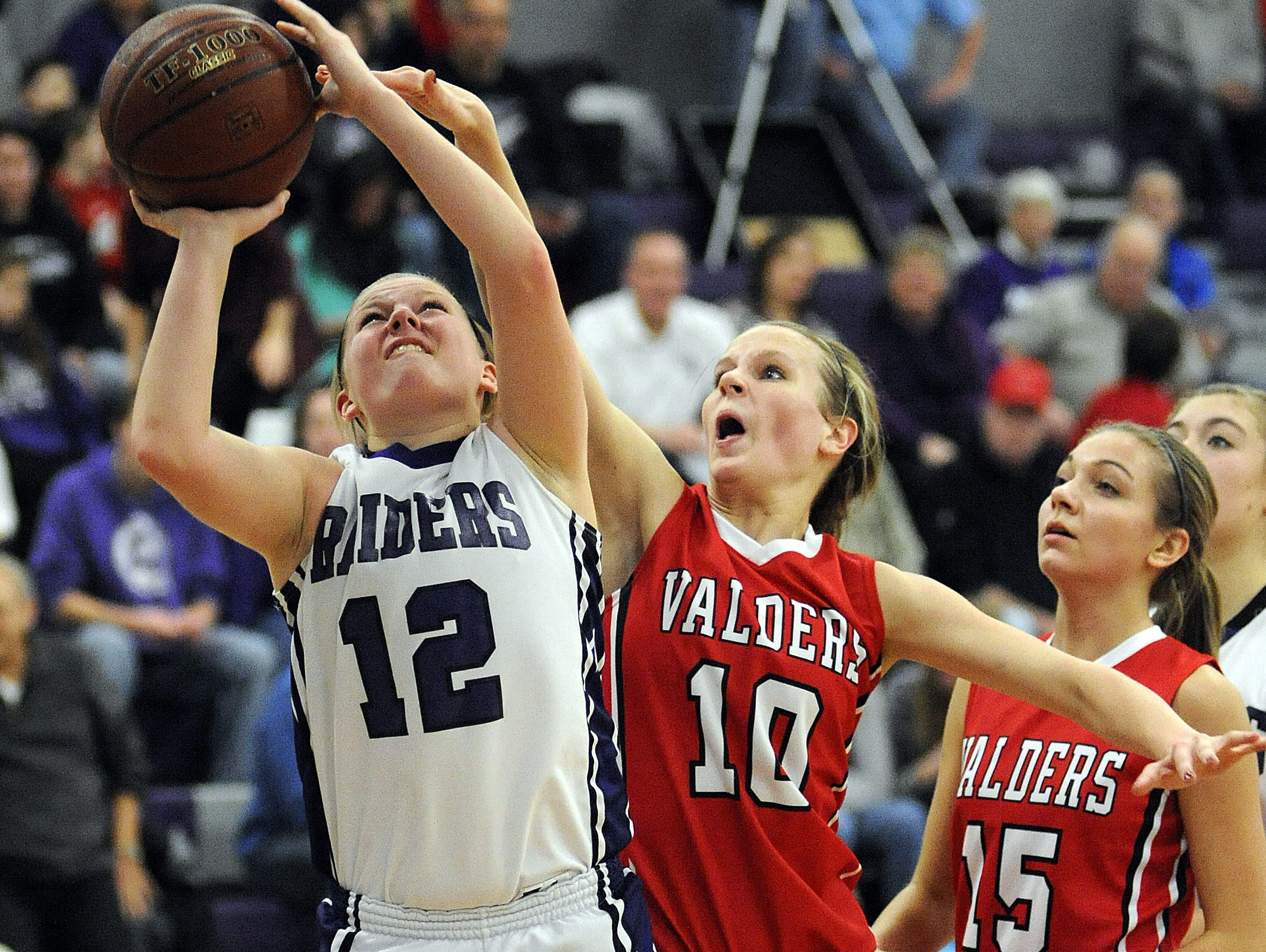 Senior Sara Winkel will be one of the top shooters in the Eastern Wisconsin Conference this season and will play a key role for the Raiders.