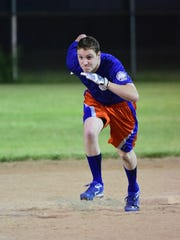 An influx of youth in recent seasons has re-energized veterans on IPS. Shown running the bases is 23-year-old Michael Szybisty, whose dad is one of the original team members.